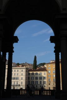 Looking through the arch to the buildings on the other side of the Arno River