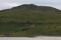 Longer shot of the red roof house