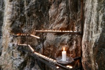 Candles positioned against the rock