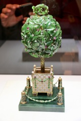 Bay Tree Easter egg, 1911 presented by Emperor Nicholas II as a gift to his mother, Dowager Empress Maria Feodorovna at Easter. The surprise was when the clockwork automation was wound up, a feathered bird appears, flaps its wings, turns its head and opens its beak. The leaves are made from jade.