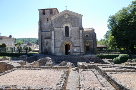 Roman ruins in the foreground with the local church built out of stones from the Roman buildings in Montcaret