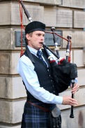 A different person playing the bagpipes