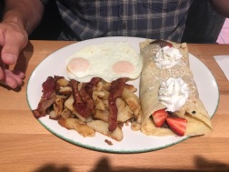 Phil's bacon, eggs, potatoes, strawberry and chocolate crepe