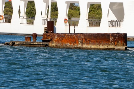 The Arizona Memorial with some of the wreckage above the water