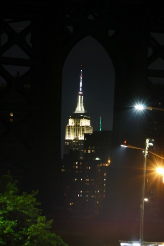 Empire State Building taken through one of the arches of the Manhattan Bridge