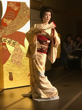 The geisha performing her dance.