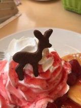 Deer cookie on top of the strawberry pancakes