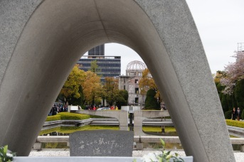 View of the A-bomb Dome through the Cenotaph for victims and the flame of peace in the middle, Hiroshima