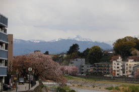 Snow capped mountains and the Saigawa River, Kanazawa, Japan